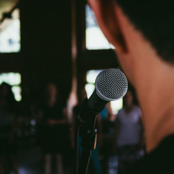 Young man preparing to speak in public.